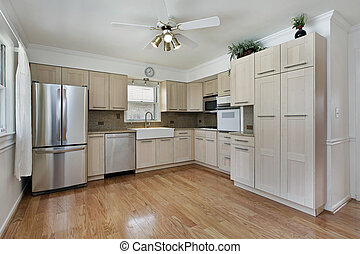 Kitchen with tan cabinetry