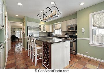 Kitchen in suburban home with terra cotta floor tile