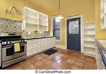 Kitchen with terra cotta floor tile - Kitchen in suburban...