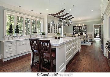 Kitchen with white granite island - Kitchen in luxury home...