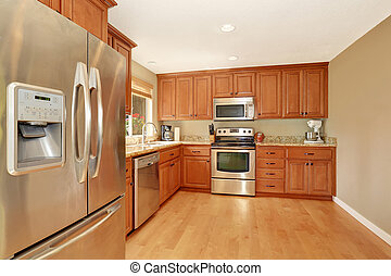 Kitchen with wooden cabinets, granite counter top and hardwood floor