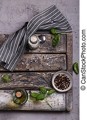 kitchen wooden background with basil