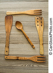 Kitchen wooden utensil of scapula, spoon and fork