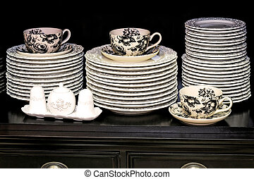 Kitchenware and china dishes and mugs in cupboard