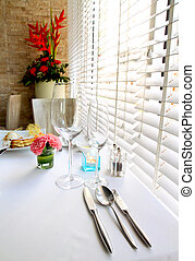 Kitchenware set on the table with decorated flower