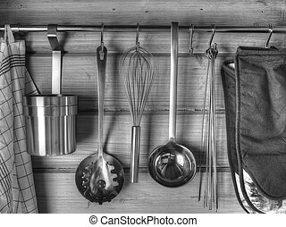 Kitchenware - The kitchenware hanging on the wall, black and...