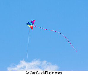 Kite - Child's toy kite in rainbow colors flying in a clear ...