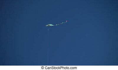 Kite flying in a clear blue sky