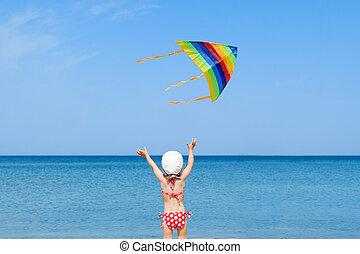 kite flying kid girl beach outdoor coast shore unrecognizable