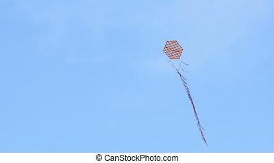 """kite flying over blue sky background, day"""