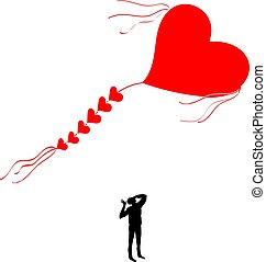 Kite shaped like a heart. Man looking at a flying kite.