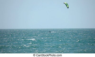 Kite surfer - Kitesurfer surfing on the waves with the kite...
