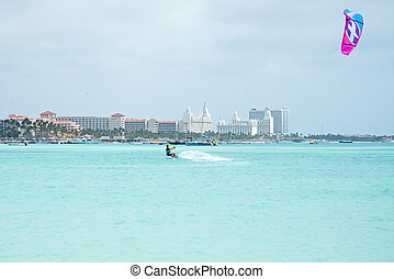 Kite surfer on Palm Beach at Aruba island in the Caribbean