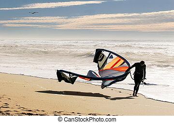 Kite surfer on the beach at Santa Cruz, California