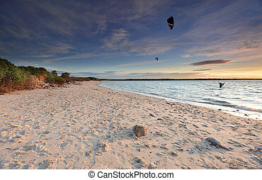 Kite Surfers at sunset on Silver Beach, Botany Bay Australia