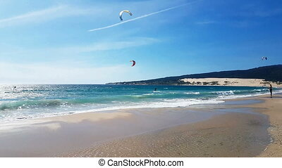Kite surfers on the mediterranean sea in a windy day