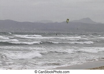 Kite surfing - As a storm blows in the kite surfers take to...