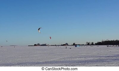 Kite surfing on winter lake