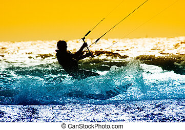 kite surfing - kite boarder action with sunset