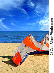 Kite surfing - Big kite for kite surfing lying on a sandy...