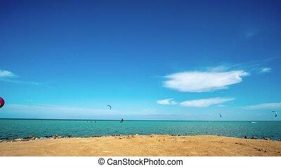 kite surfing. surfers on blue sea surface. hyperlapse - kite...
