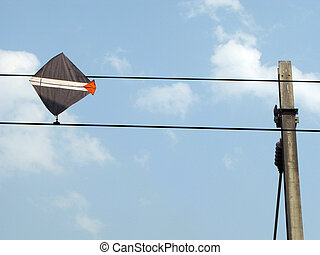 Kite Trapped on Wires
