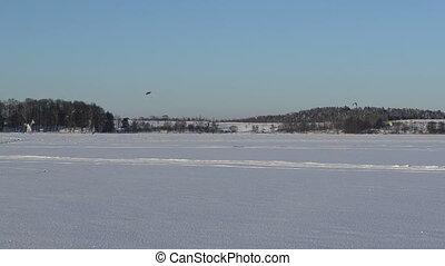 kiteboard snowboard sail - people ice sailing and...