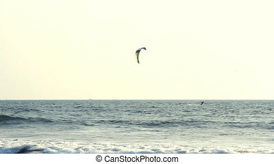 Kiteboarder enjoy surfing in the sea at sunny day