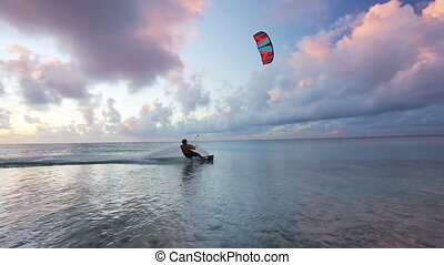 kiteboarding at sunset - kite surfing at sunset. fun in the...