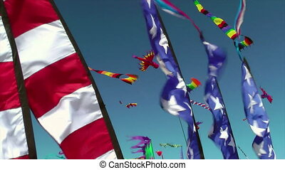 Kites and banners blowing in the wi