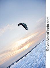 Kitesurf (kiteboarding at sunset, winter scene)