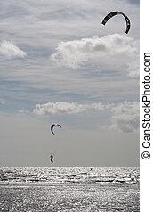 Kitesurfer getting big air