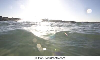 Kitesurfer jumps and splash of water goes into the camera -...