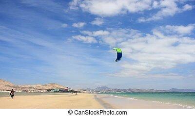 Kitesurfer walk on a beach with Softkite on Fuerteventura...