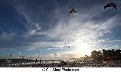 Kitesurfers at sunset time - Kite surfing on the beaches of...