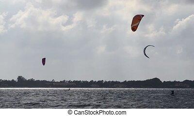 Kitesurfers in action