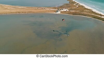 Kitesurfing in the Azov sea. Aerial 4k cinematic kite...