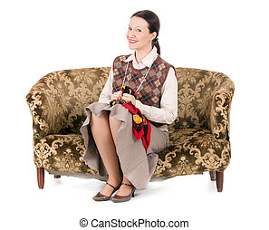 smiling kitsch woman sitting on retro old fashioned sofa