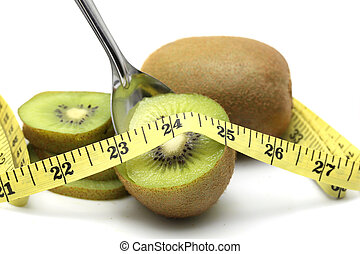 kiwi and tape measure. Lose weight concept
