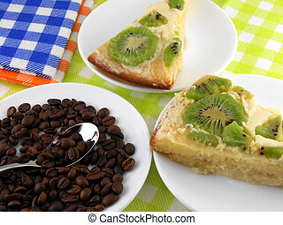kiwi cake on white plate with coffee beans