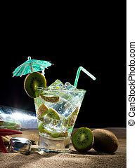 Kiwi cocktail on the sand
