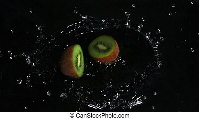 kiwi falls into the water, slow motion