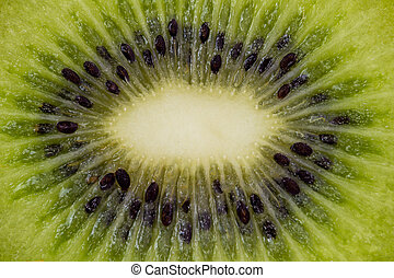 Kiwi fruit cuted in a half top macro view