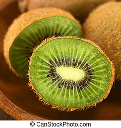 Kiwi Fruit - Kiwi fruits on wooden plate (Selective Focus,...