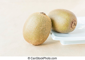 Kiwi fruit on a brown background