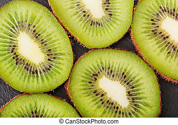 Kiwi fruit on a dark background, food.