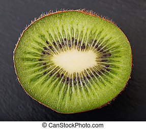 Kiwi fruit on a dark background