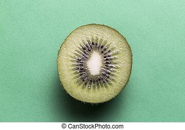 Kiwi fruit on a green background