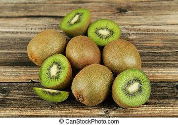 Kiwi fruit on brown wooden background