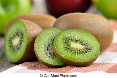 Kiwi fruit on old wooden